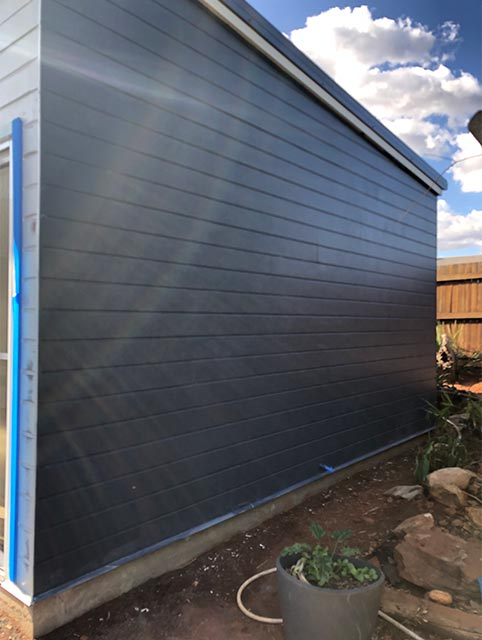 Side of studio painted ready for the aircon