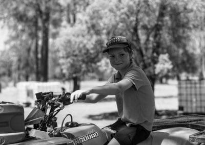 Child on four wheeler without a care in the world