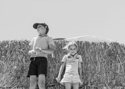 Kids up high on the hay stack