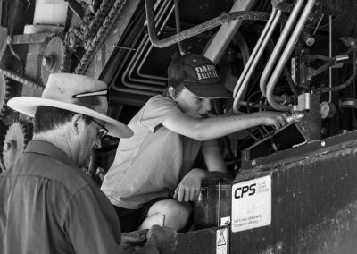 Son helping Dad fix the header