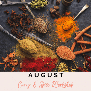 display of food spices over spoons of a table