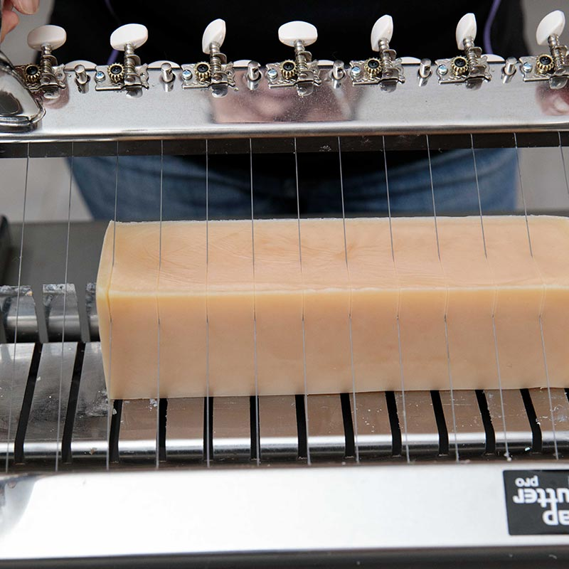 cutting large log of soap